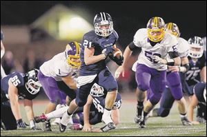 Napoleon's Max Westhoven runs the ball against Bryan. He has gained 481 yards. He leads the Wildcats with 84 tackles.