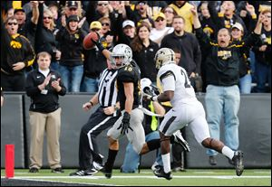 Iowa's Micah Hyde, left, scored on a fumble recovery for the Hawkeyes in a loss to Purdue.