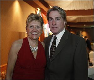 Radio personality Mary Beth Zolik, seen here last year with fellow emcee Rick Woodell at the American Heart Association's 14th annual Glass City Heart Ball