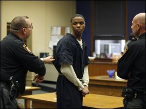 Reynard Lewis appears  in Lucas County Common Pleas Court for the murders of Darnell Townsend-Tall and Raynail Gaiter. He faces life in prison.