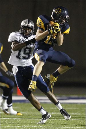Whitmer's Nate Holley intercepts a pass intended for Hudson's Leighton Antonio. The Panthers have allowed an average of just 8.6 points per game.