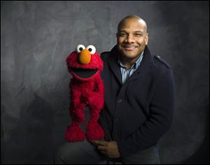 Elmo puppeteer Kevin Clash with the 'Sesame Street' muppet.