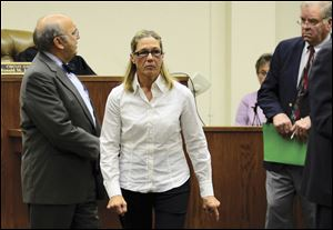 Former Dixon, Ill., comptroller Rita Crundwell leaves a courtroom in Dixon with her attorney Paul Gaziano, left, in October, after making her first appearance in the northern Illinois city to face charges she siphoned millions of dollars in public funds into a secret bank account.