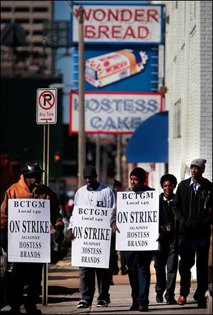 Members of the Bakery, Confectionery, Tobacco, and Grain Millers union picket outside a Hostess bakery in Memphis. The strike began Nov. 9 after a bankruptcy judge imposed concessions.
