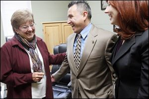 Employee Shirley Briggeman, left, shares a laugh with Ron and Cathy Tijerina. The Tijerinas are leasing the former Hope School in Henry County for the Ridge Project, which tries to help prison inmates and their families grow together and gain skills.