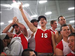 Owens Community Collge's student cheering section reacts after their team scored the match winning point.