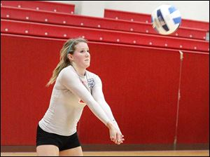 Owens Community College's freshman defensive specialist Lisa Urbanski returns an opponent's serve.