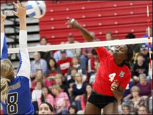 Owens Community College's freshman outside hitter Dakia Sellers delivers a spike.