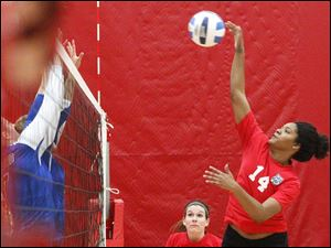 Owens CommunityCollge's freshman middle blocker Jazmine Thomas delivers a spike.