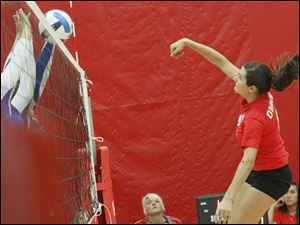 Owens Community College's freshman outside hitter Dominique Yates delivers a spike.