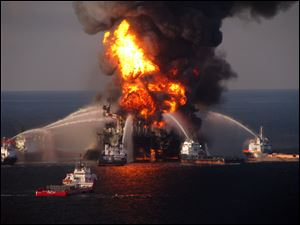 The U.S. Coast Guard, fire boat response crews battle the blazing remnants of the off shore oil rig Deepwater Horizon.