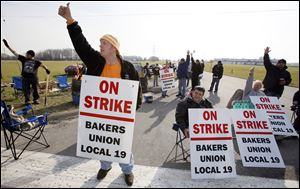 Randy Moore and other employees of the Hostess plant in Northwood picket Thursday.