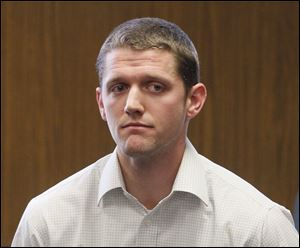 Matthew Warner, a former Washington Local school teacher and coach, sits in court at his February sentencing.