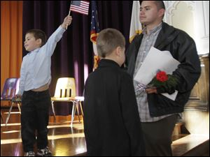 Alex Garcia, 4, left, his brother Miguel, 6, and dad Inocencio Garcia, all of Ney, Ohio after the ceremony. Inocencio became a citizen during the proceedings.