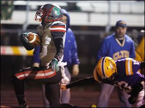 Central Catholic's Jayme Thompson (8) returns an interception for a touchdown against Avon.