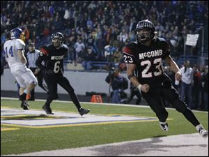 McComb High School player Jerry Brown, 23, celebrates after scoring the winning touchdown.
