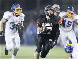 McComb High School player Cody Wilson, 27, out runs the Delphos St. John's defense to score a touchdown.