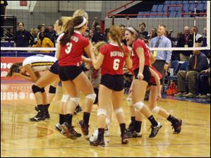 Sophia Marciniak (3), Maddie Andres (6) and other members of the Bedford High School volleyball team celebrate their Class A semifinal win.