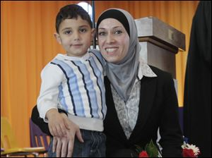 Rami Albadour, 3, and his mom Suzan Dahmous, formerly of Jordan, after the ceremony.