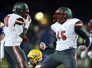 Central Catholic's Chris Green (45) celebrates after sacking Avon QB David Zeh (4).