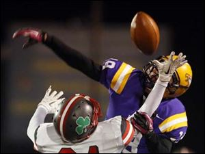 Avon's Zack Torbert (19) breaks up a pass intended for Central Catholic's Derich Weiland (24).