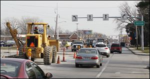 Lanes are reduced as gas line construction continues Thursday on Monroe Street, between Secor Road and Sylvania Avenue.
