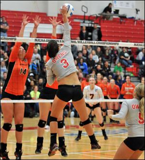 Owens' Alyssa Meis, a Genoa High School alumna, attempts one of her 15 kills Friday night as the the Express lost to No. 1 Cowley County in the NJCAA Division II semifinal.