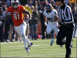 BGSU's Chris Gallon is chased by Kent's C.J. Malauulu as he runs in for a touchdown.