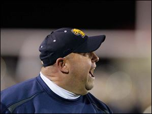 Whitmer High School head coach Jerry Bell argues a call with an official.