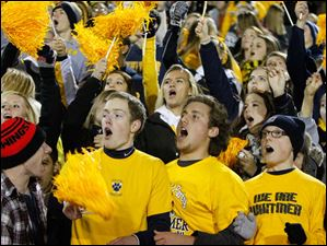 Whitmer High School fans cheer their team against Massillon Washington High School.