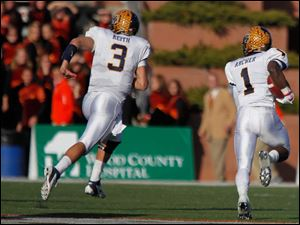 Kent State quarterback Spencer Keith, left, trails with Dri Archer into the end zone.