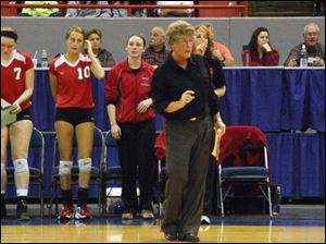 Bedford high School volleyball coach Jodi Manore gives instructions from the sidelines.