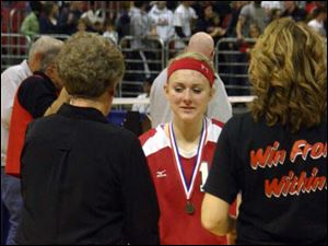 Bedford High School senior Lexie Curtis receives a handshake from volleyball coach Jodi Manore.