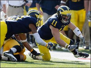 Michigan safety Jordan Kovacs (11) chases a loose ball.