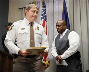 Sylvania Township police Chief Robert Boehme, left, and Toledo police Chief Derrick Diggs are grim after discussing the   carbon monoxide poisoning deaths. They addressed reporters Friday at the Safety Building in Toledo.