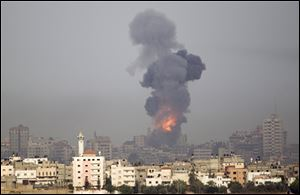 Explosion and smoke rise following an Israeli strike in Gaza, seen from the Israel Gaza Border, southern Israel, Saturday.