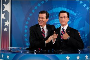 Stephen Colbert reacts to seeing his wax figure for the first time Friday at Madame Tussauds in Washington.