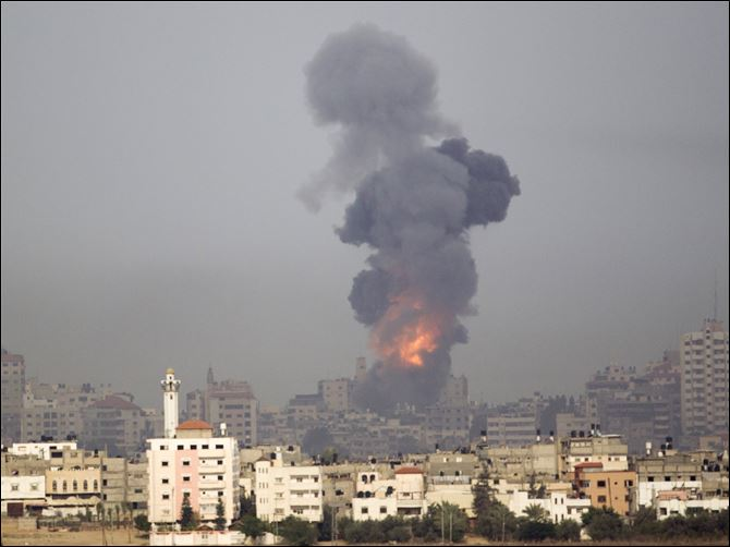 APTOPIX Mideast Israel Palestinians Explosion and smoke rise following an Israeli strike in Gaza, seen from the Israel Gaza Border, southern Israel, Saturday.
