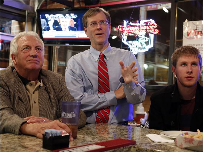GOP politics  Ron Rothenbuhler Jon Stainbrook Left to right Lucas County Democratic party chairman Ron Rothenbuhler, Lucas County Republican party chairman Jon Stainbrook , and Jeremiah VanBuren watch the presidential debate last month.