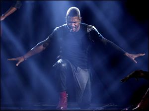 Usher performs at the 40th Annual American Music Awards on Sunday, Nov. 18, 2012, in Los Angeles. (Photo by Matt Sayles/Invision/AP)