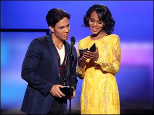 Apolo Anton Ohno, left, and Kerry Washington present the award for favorite artist in alternative rock.