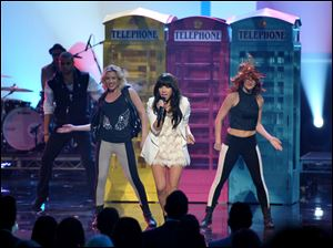 Carly Rae Jepsen and dancers perform.