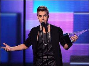 Justin Bieber accepts the award for favorite male artist in pop/rock.