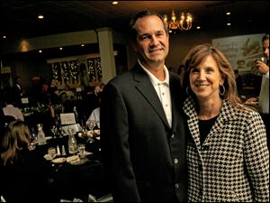 Dean Monske, of Regional Growth Company, and Sharon Speyer, president of Huntington Bank, enjoy the Chef's Auction to benefit March of Dimes.