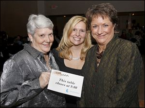 Carolyn Ruge, left, mingles with event chair Tonya Robinson, center, and Kidney Foundation of Northwest Ohio executive director Holly Hoagland-Fojtik during the 21st annual Wine Affair.