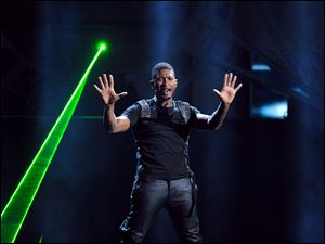 Usher performs at the 40th Annual American Music Awards.