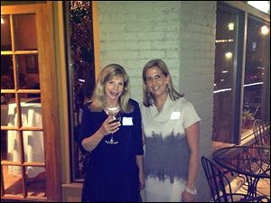 Mingling at the Toledo Animal Shelter Auxiliary's wine event were Pamela Roberts and Kate Kelley, the event chairmen.