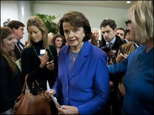 Senate Intelligence Committee Chair Sen. Dianne Feinstein (D., Calif.) is surrounded by reporters after speaking, on Capitol Hill in Washington, Friday, following a committee's closed-door hearing where former CI