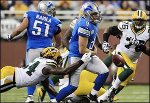Green Bay Packers linebacker Dezman Moses, left, strips the ball away from Detroit Lions quarterback Matthew Stafford during the second quarter Sunday at Ford Field in Detroit. Green Bay recovered. Stafford went 17 of 39 for 266 yards with two interceptions, one of which was returned for a touchdown in the third quarter.