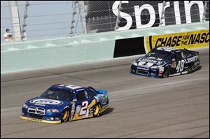 Brad Keselowski, left, and Jimmie Johnson compete during the NASCAR Sprint Cup Series race Sunday in Homestead in Homestead, Fla. Keselowski, 28-year-old Detroit native, won his first NASCAR champion